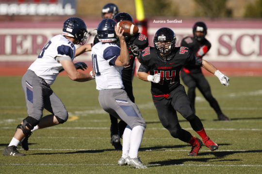 Eaglecrest linebacker, Kyle Wagner, 44, breaks through the offensive line to apply heavy pressure on Columbine quarterback, Logan DeArment, 10, during the class 5A football semifinal contest, Nov. 25 at Legacy Stadium. Eaglecrest defeated Columbine in dou