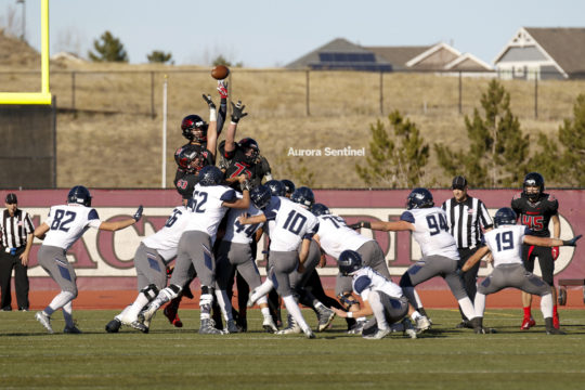 The Eaglecrest defensive line blocks a tying field goal in the fourth quarter of the class 5A football semifinal contest against Columbine, Nov. 25 at Legacy Stadium. Eaglecrest defeated Columbine in double overtime 32-31 and will face Pamona in the 5A fo