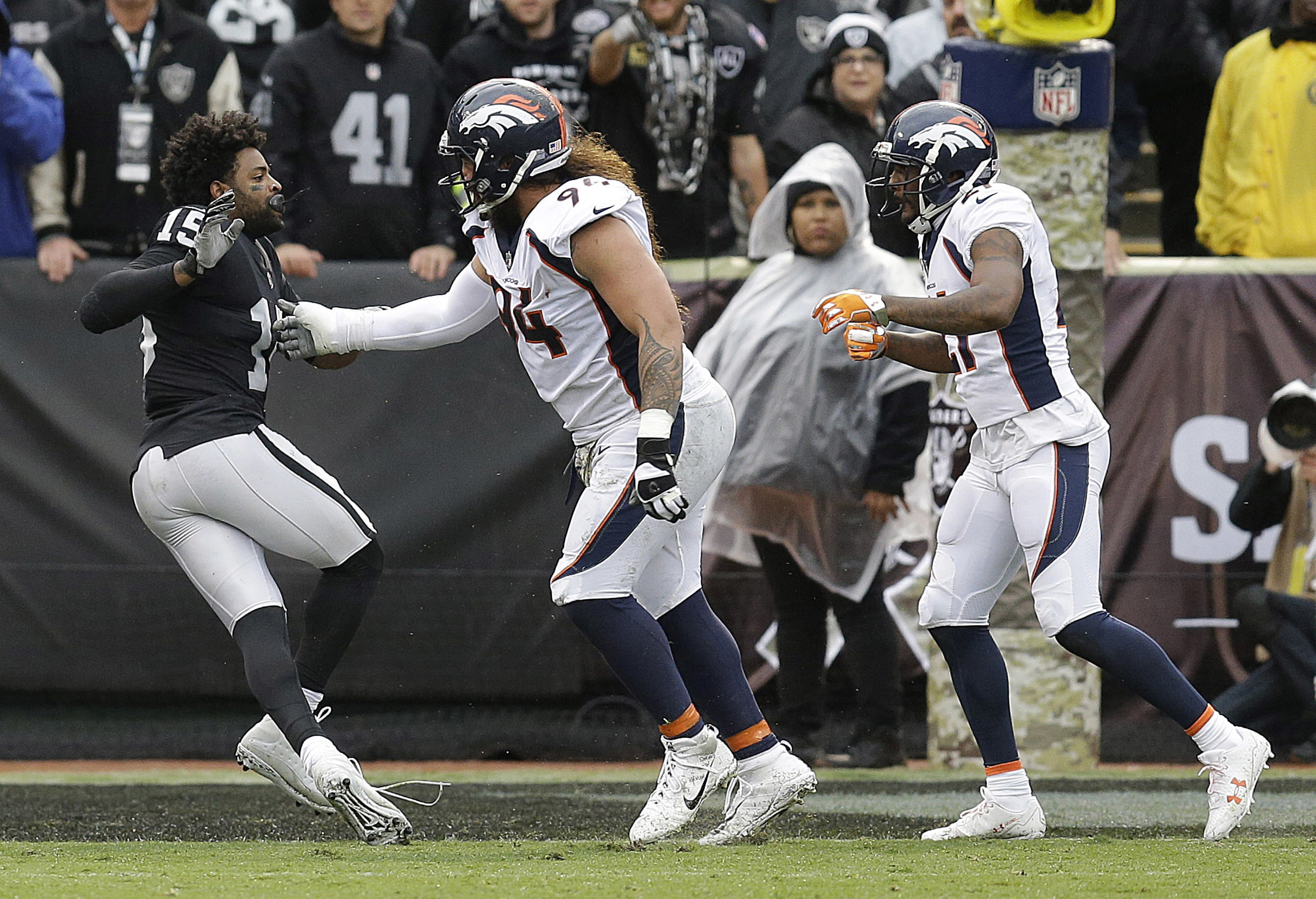 Oakland Raiders Wide Receiver Michael Crabtree Left Fights With Denver Broncos Nose Tackle Domata Peko Center And Cornerback Aqib Talib During The First