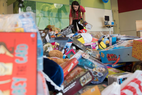 Alyssa Wajcik, who is a staff member of Children's Hospital Colorado, sorts a mere fraction of the toys that were donated during the 32nd Annual Children's Hospital Colorado Toy Run, Dec. 3. Thousands of motorcyclists travelled in a convoy from Aurora Spo