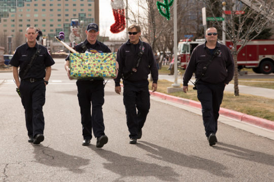 Firemen from the Aurora Fire Department deliver a box of toys to the Children's Hospital Colorado Dec. 3 during the 32nd Annual Children's Hospital Colorado Toy Run. 