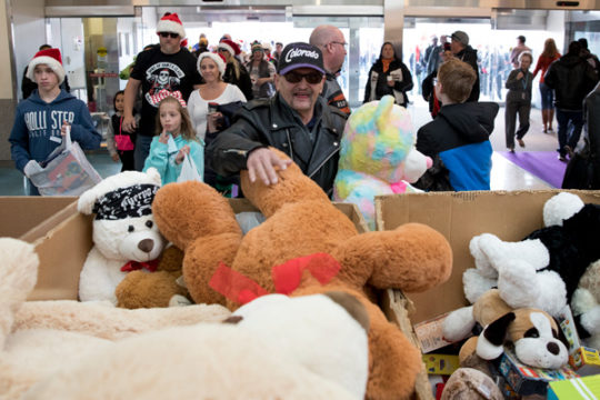 Johnny Lopez donates two giant teddy bears Dec. 3 during the 32nd Annual Children's Hospital Colorado Toy Run. This is Johnny's third time participating in the event where thousands of motorcyclists meet at Aurora Sports Park and travel in a convoy to the