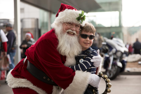 Caleb Aldrich, 6, gets a hug from Santa Claus at the Children's Hospital Colorado, Dec. 3, during the 32nd Annual Children's Hospital Colorado Toy Run, where thousands of bikers delivered toys to the children.Photo by Philip B. Poston/Aurora Sentinel