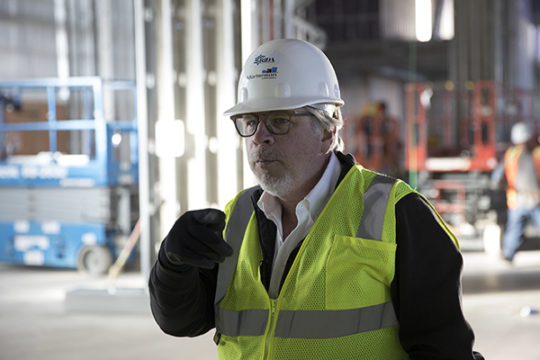 Dave Bray, Vice President of Architecture and Construction at RIDA Development Corporation, explains the many intricacies of working on the current largest hotel construction project in the country, Dec. 4 at the site of The Gaylord Rockies Resort and Con