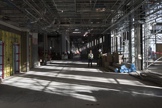 Construction workers stand in the hallways of the convention center. Photo by Philip B. Poston/Aurora Sentinel