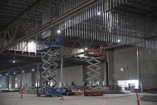 Construction workers on scissor lifts work in the 175,000 sq. ft. convention center.Photo by Philip B. Poston/Aurora Sentinel