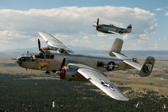 A WWII-Era B-25 Bomber plane and a P-47D Thunderbolt fly in formation, Sept. 13, over East Aurora as part of a demonstration for the upcoming Pikes Peak Regional Air Show which will be Sept. 23-24 at the Pikes Peak Airport.  Photo by Philip B. Poston/Aur