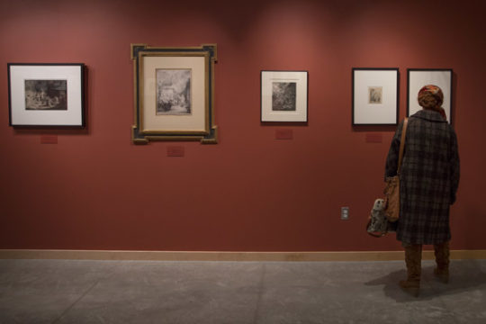 Laura Lustig, a dental student at the Anschutz Medical Campus, views the collection of Rembrandt etchings, Oct. 9 in The Art Gallery of the Fulginiti Pavilion for Bioethics and Humanities. Photo by Philip B. Poston/Aurora Sentinel