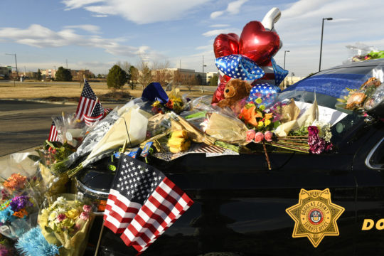 Officers escort body of fallen Colorado deputy