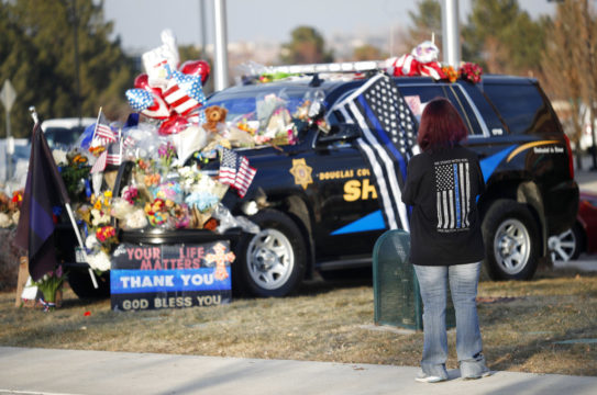 Douglas County Colo. Sheriffs Department vehicle covered with tributes to fallen deputy