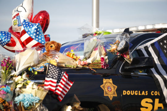 Douglas County, Colo., Sheriffs Department vehicle covered with tributes to fallen deputy