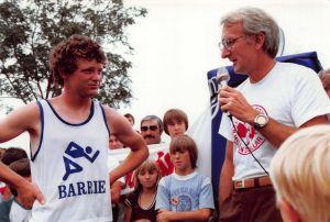 1980-07-26-Downtown- Race organizer George Taylor addresses Terry Fox as he runs through Barrie during Ten MIlion Dollar Miracle of Hope Run across Canada. (A)