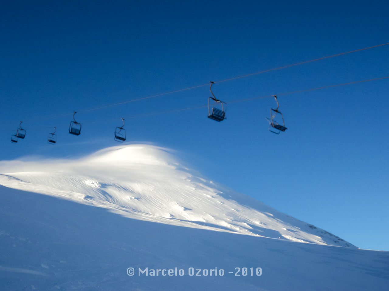 Chair lifts of Osorno Volcano, Patagonia, Chile. Really cool place to snowboard, once you have a good weather. This picture was taken in 2010 season. This winter resort is rarely crowded. Mainly, you do out of piste.
