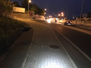 Walking along a busy highway at night during the Camino Portuguese.