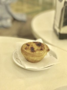 Pastry de Nata is a popular Portuguese treat. It has custard inside a baked crust. Often heated and topped with cinnamon and powdered sugar. Yum!