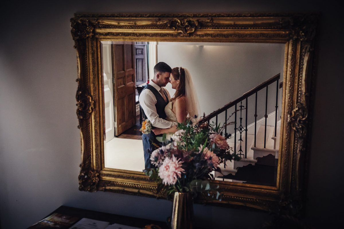 Wedding Photography Backwell House Bristol_bride and groom in mirror