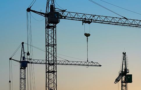 tower cranes at dusk