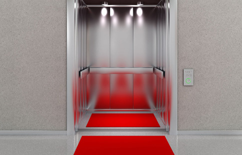 open elevator with red carpet