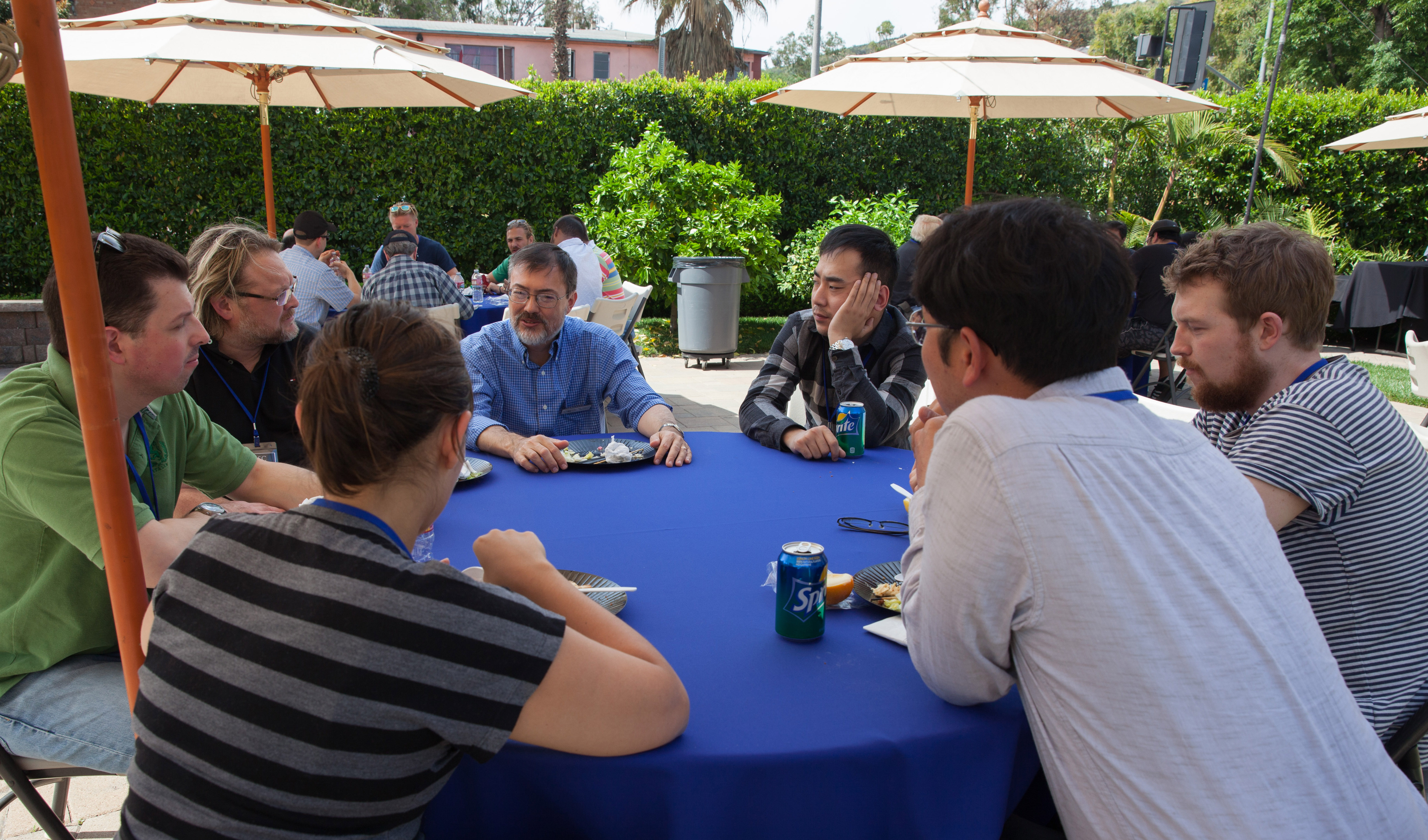 Instructor M. David Mullen, ASC (center, wearing blue shirt), joins Master Class participants on the Clubhouse lawn.