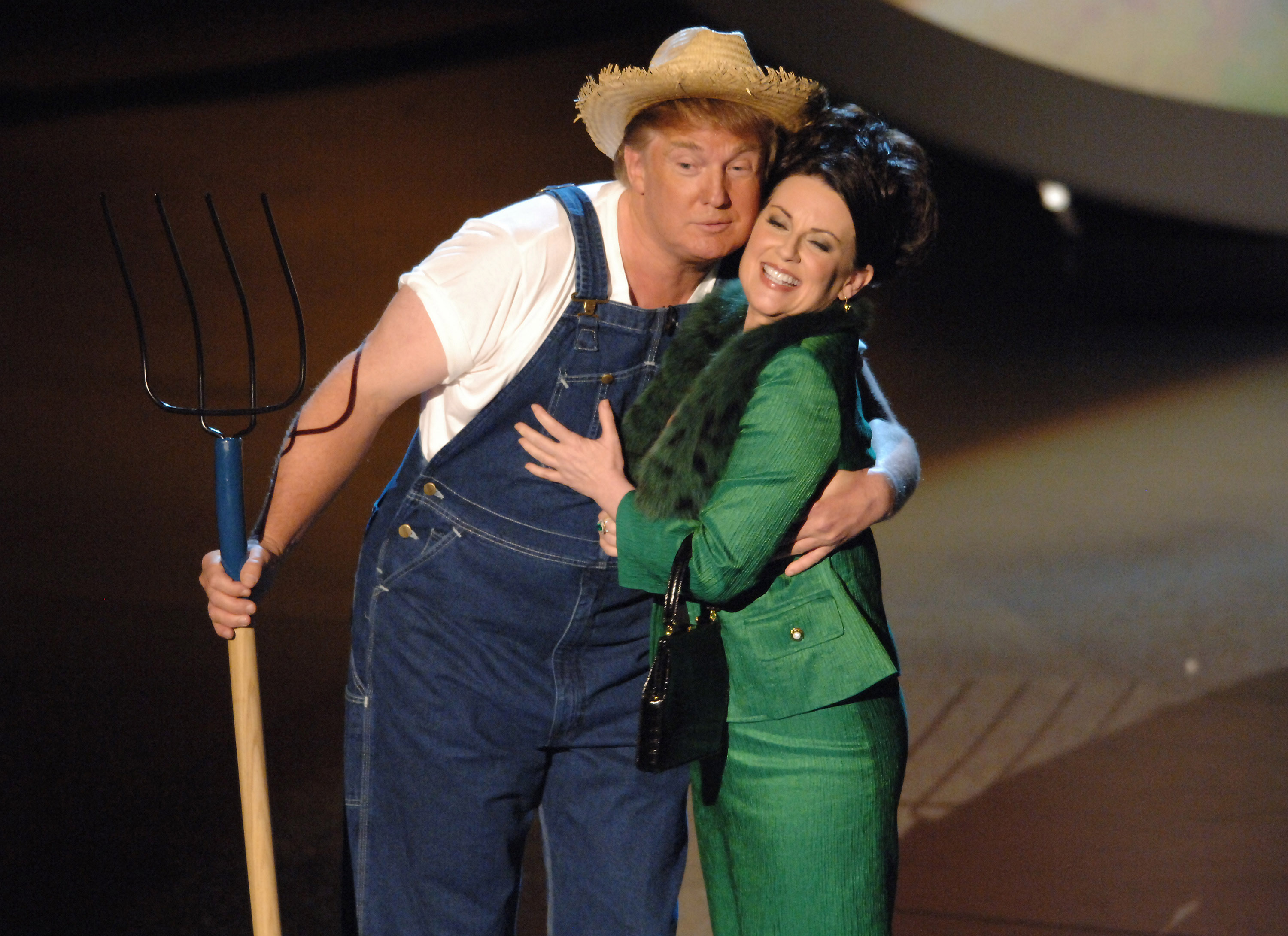 "Donald Trump and Megan Mullally perform the ""Green Acres"" theme song for Emmy Idol (Photo by M. Caulfield/WireImage)"