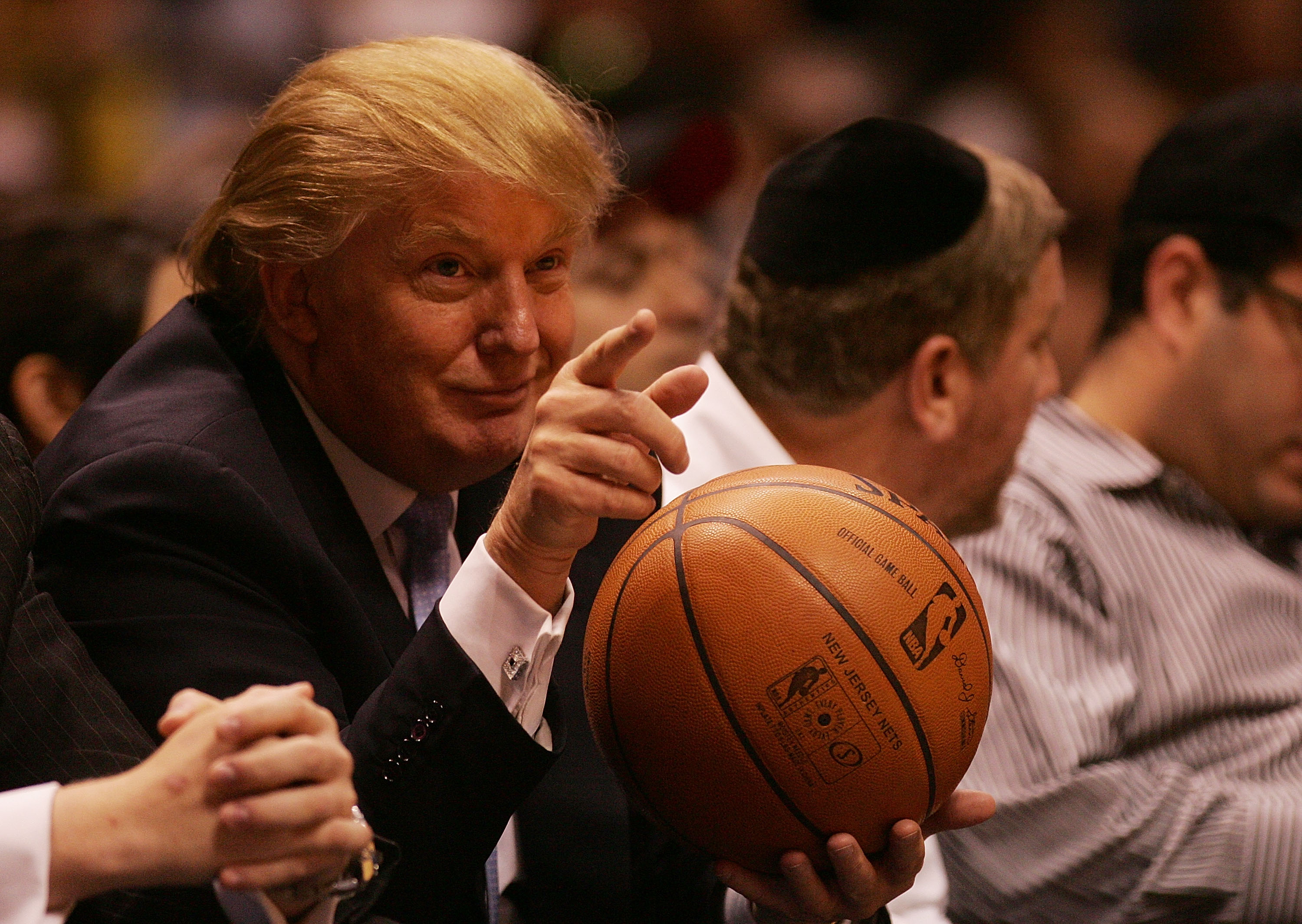 EAST RUTHERFORD, NJ - OCTOBER 31:  Donald Trump sits courtside at the New Jersey Nets and the Chicago Bulls game at the Izod Center on October 31, 2007 in East Rutherford, New Jersey. NOTE TO USER: User expressly acknowledges and agrees that, by downloading and or using this photograph, user is consenting to the term and conditions of the Getty Images License Agreement (Photo by Nick Laham/Getty Images)
