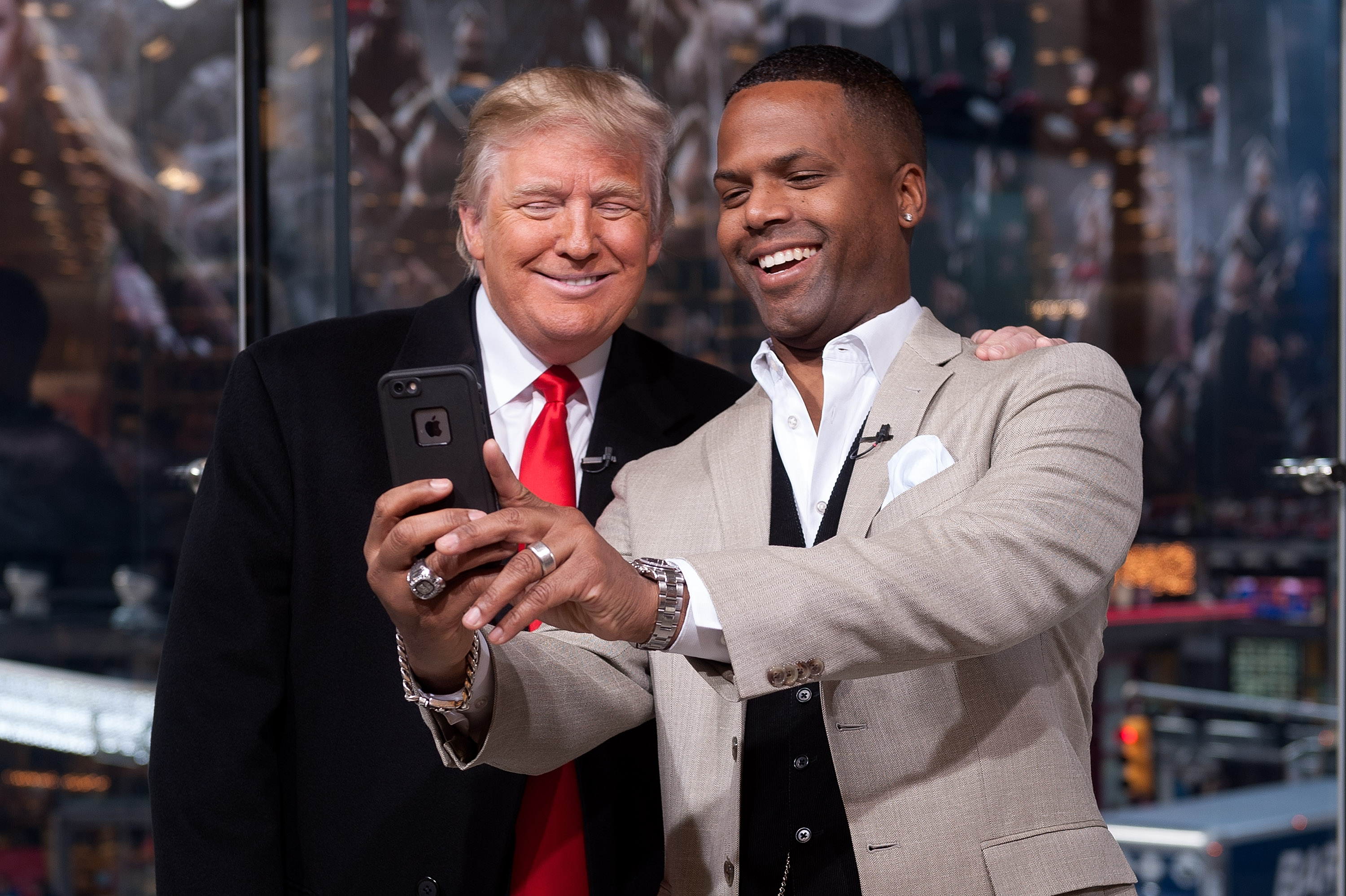 NEW YORK, NY - DECEMBER 17:  AJ Calloway (R) interviews Donald Trump during his visit to 'Extra' at their New York studios at H&M in Times Square on December 17, 2014 in New York City.  (Photo by D Dipasupil/Getty Images for Extra)