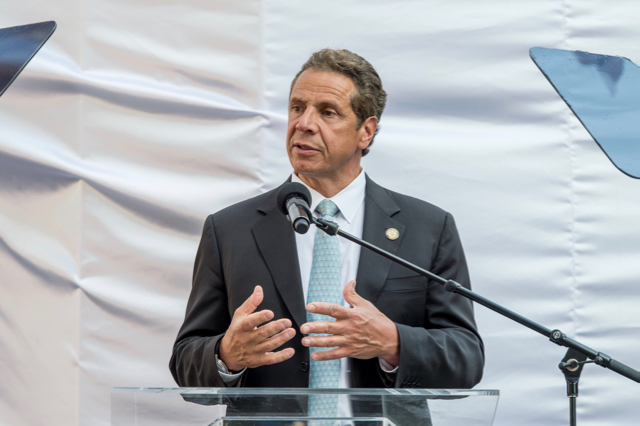 New York will delay enforcement of an ethics law championed by Governor Andrew Cuomo, pictured here speaking during the Cadillac House Grand Opening. (Photo by Roy Rochlin/FilmMagic)