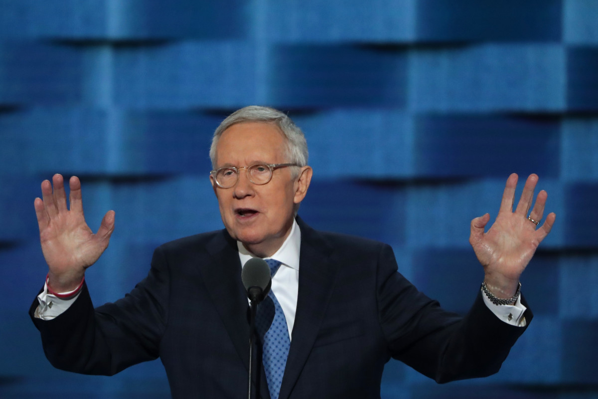 PHILADELPHIA, PA - JULY 27:  U.S. Sen. Minority Leader Sen. Harry Reid (D-NV) gestures to the crowd as he delivers remarks on the third day of the Democratic National Convention at the Wells Fargo Center, July 27, 2016 in Philadelphia, Pennsylvania. Democratic presidential candidate Hillary Clinton received the number of votes needed to secure the party's nomination. An estimated 50,000 people are expected in Philadelphia, including hundreds of protesters and members of the media. The four-day Democratic National Convention kicked off July 25.  (Photo by Alex Wong/Getty Images)