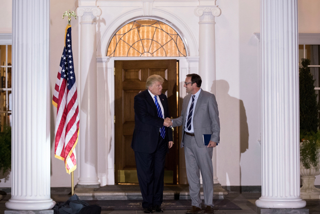 Donald Trump meets with Todd Ricketts.  (Photo by Drew Angerer/Getty Images)