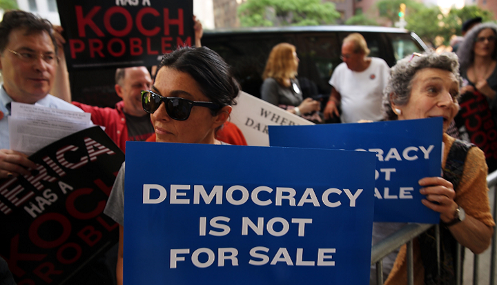 Activists hold a protest near the Manhattan apartment of billionaire and Republican financier David Koch. Photo by Spencer Platt/Getty Images