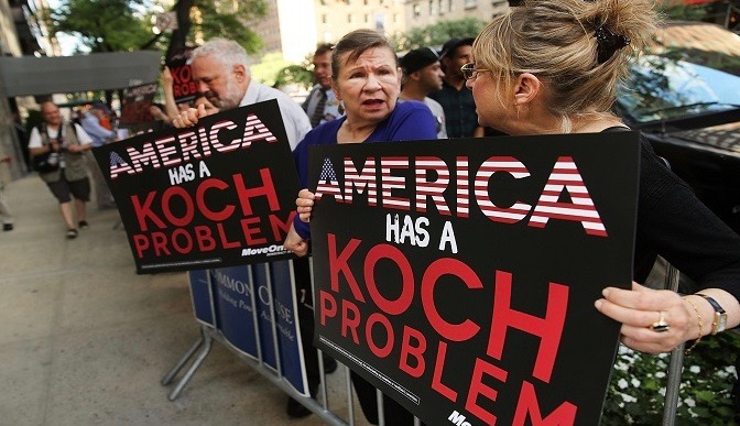 Activists hold a protest near the Manhattan apartment of billionaire and Republican financier David Koch. (Photo by Spencer Platt/Getty Images)