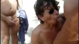 A French mature dogging Blowbang at the beach