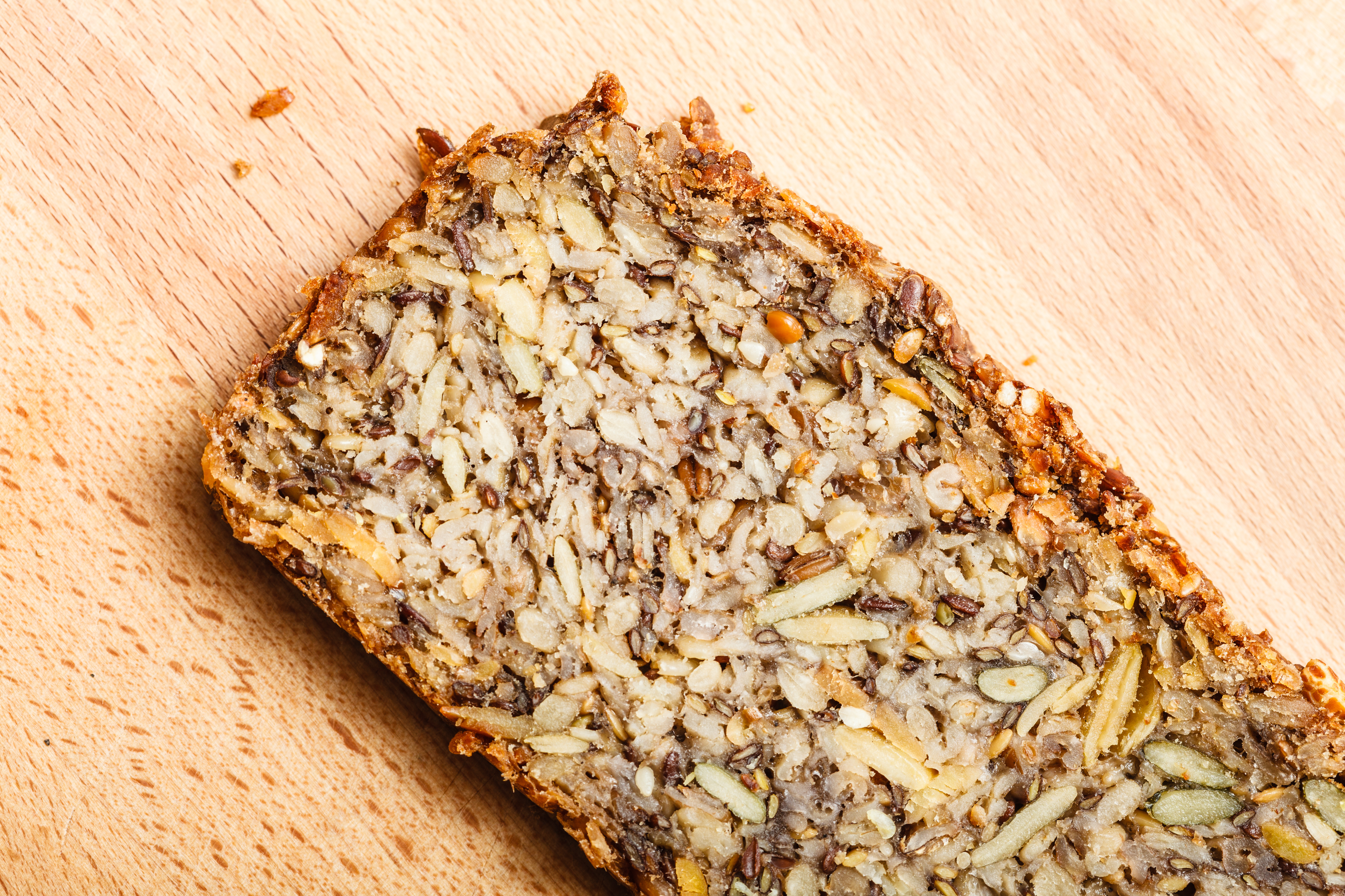 Healthy food, fit diet products concept. Whole grain bread with many big grains