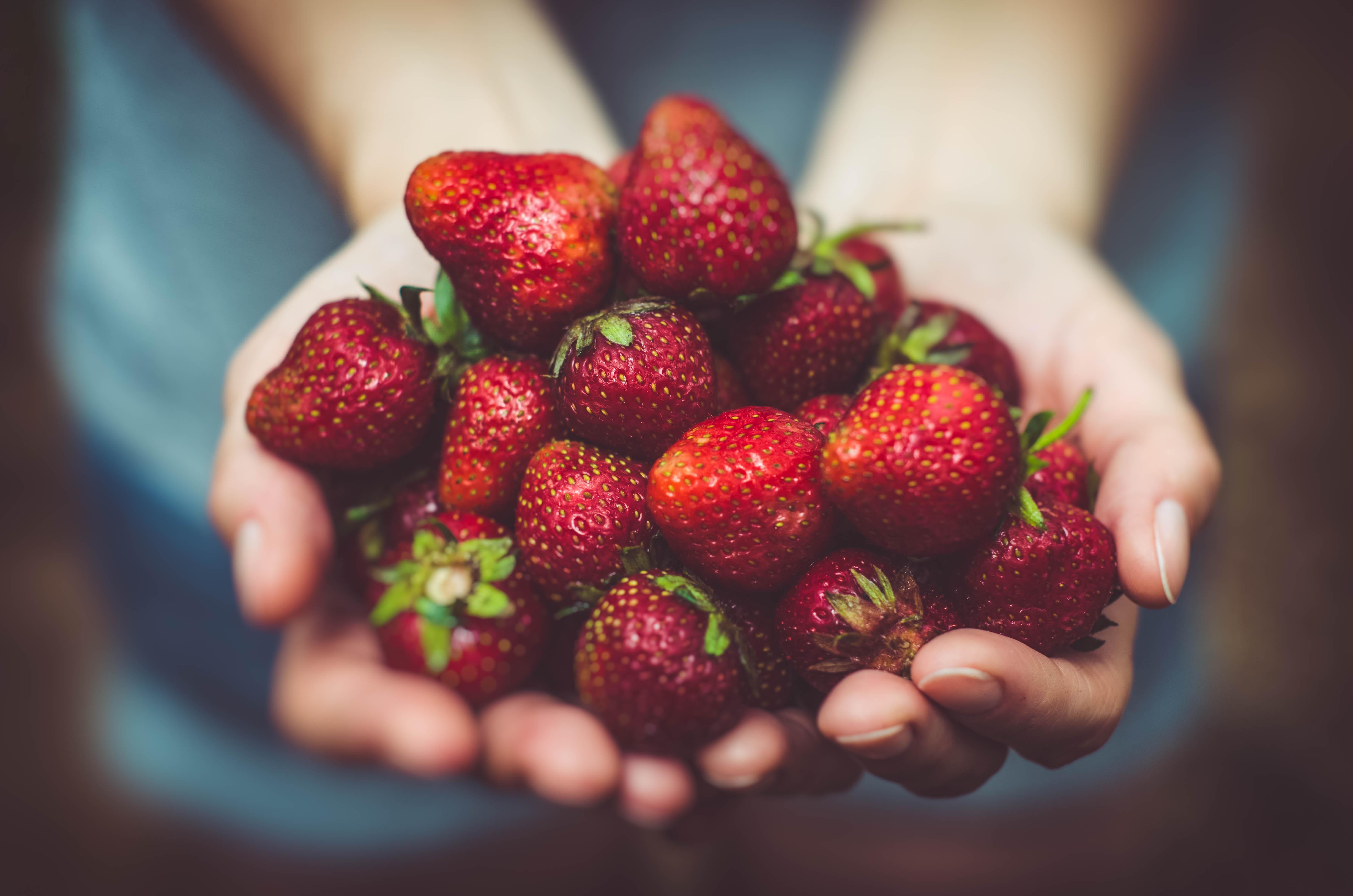 strawberries hands healthy eating