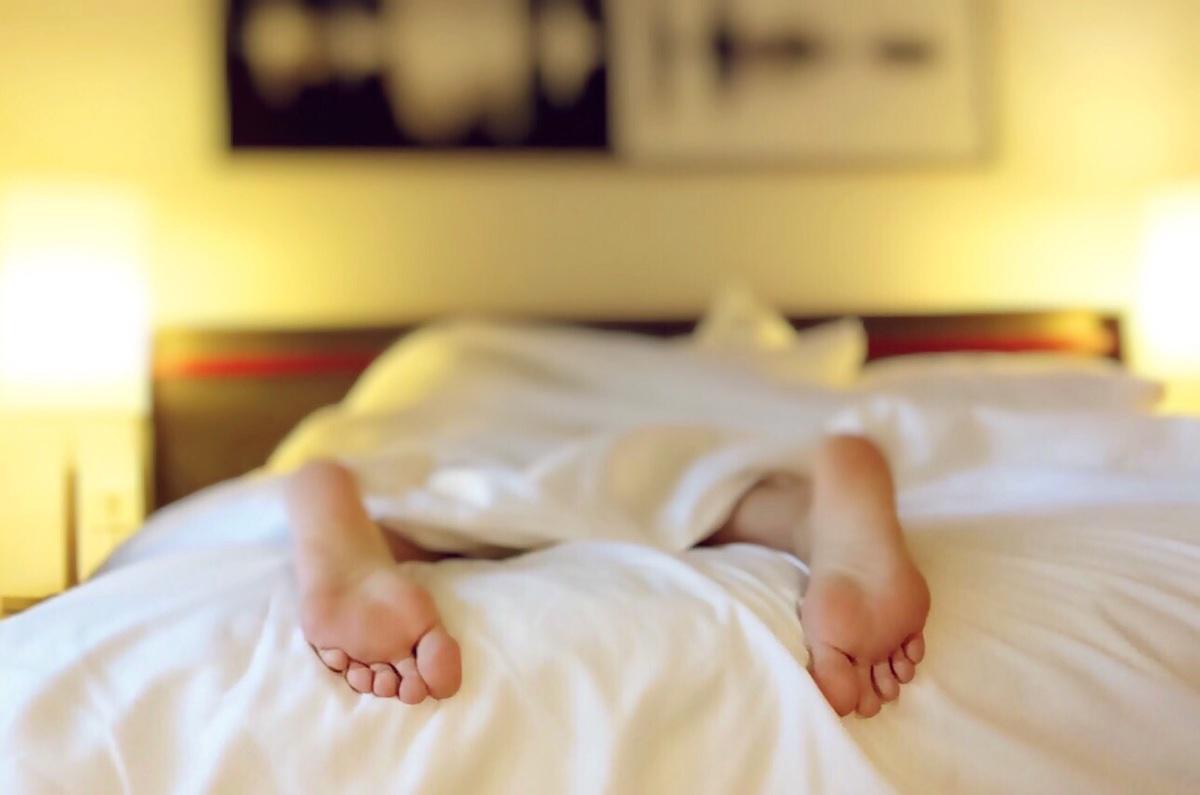 sleeping feet white bed
