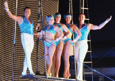 Performers from the Flying Caceres posing for a picture during a show.