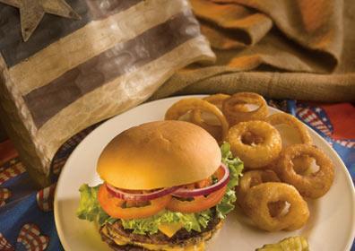 A hamburger and onion rings from Americana Café