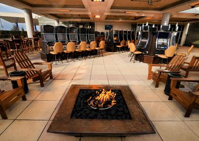 A view of the Courtyard Smoking Patio from the fire pit lounge area at Eldorado Scioto Downs