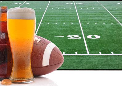 Football field background with a bottled beer, draft beer and football on the left