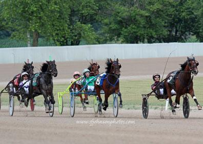 A live action shot in the evening of live harness racing at Eldorado Scioto Downs