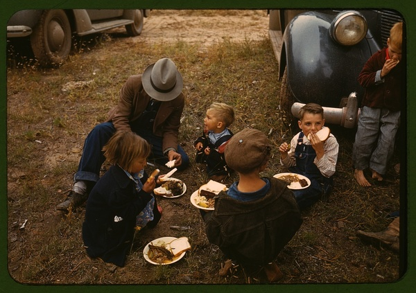 Homesteader and his children eating barbeque at the Pie Town, New Mexico Fair
