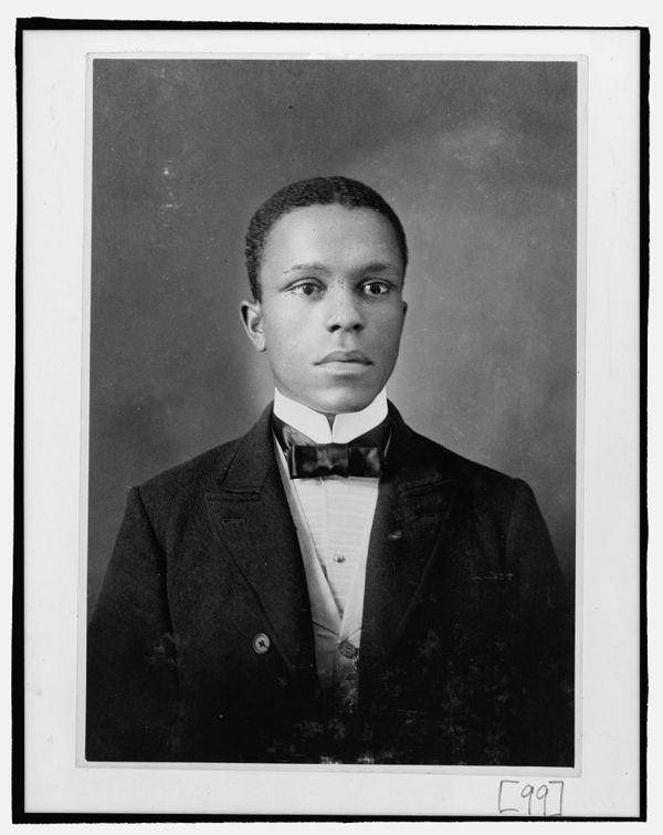 Young African American man, head-and-shoulders portrait, facing slightly right