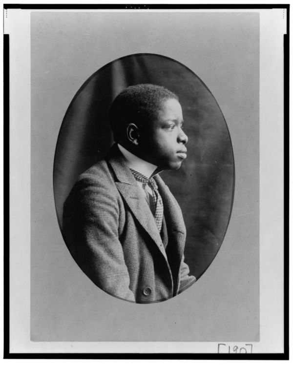 African American man, half-length portrait, right profile