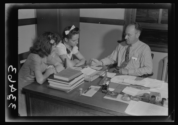 Keysville, Virginia. Randolph Henry High School. Mr. J. M. Garber, principal, working with two students on their next semester's schedules