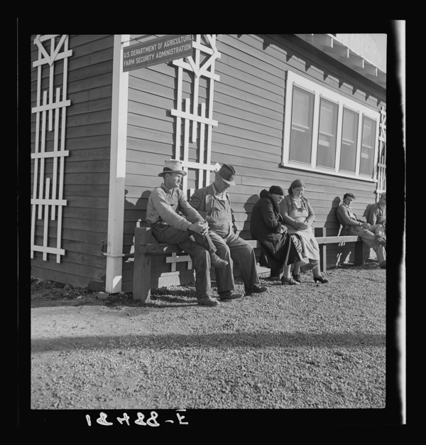 Lineup outside of Farm Security Administration grant office (relief to farm laborers) early in the morning, before the office has opened. Tulare, California