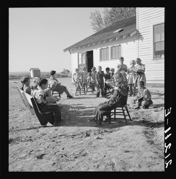 Entire enrollment of Lincoln Bench School. Teacher in center. Near Ontario, Oregon, Malheur County. General caption number 69