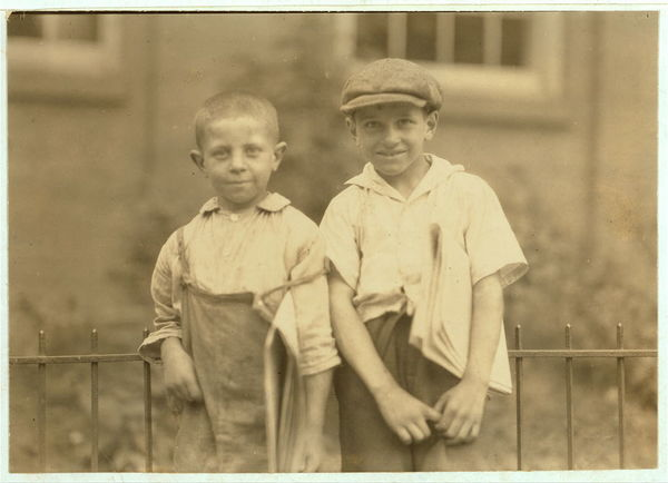 Two of the youngest newsboys in Hartford, Connecticut. They are cousins eight and ten years old. August 25, 1924.  Location: Hartford, Connecticut.