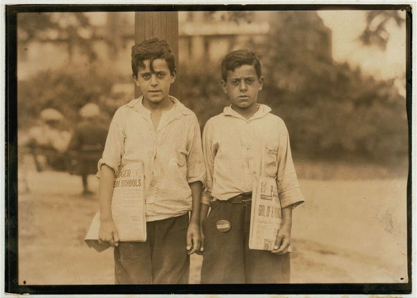 Eddie and Carmine Zizza, twelve year old twins who make $1.50 a day. They belong to a family of 13 children many of them newsboys. Newark, N.J. - August 1st, 1924.  Location: Newark, New Jersey.