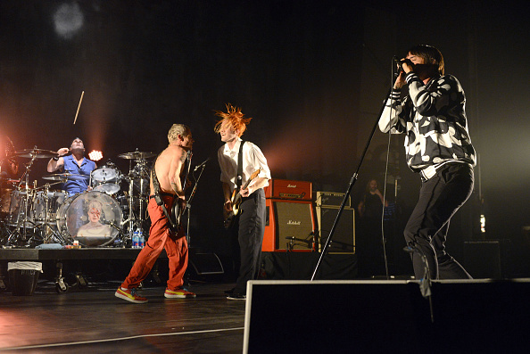 """LOS ANGELES, CA - FEBRUARY 05:  (L-R) Musicians Chad Smith Flea, Josh Klinghoffer and Anthony Kiedis of the Red Hot Chili Peppers perform onstage  during the """"Feel the Bern"""" fundraiser for Presidential candidate Bernie Sanders at the Ace Theater Downtown LA on February 5, 2016 in Los Angeles, California.  (Photo by Scott Dudelson/WireImage)"""