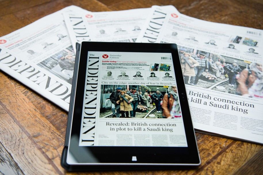 """A tablet displays a digitised version of the front page of the final print edition of the Independent newspaper in London on March 26, 2016. The final print edition of The Independent newspaper went on sale March 26, ending its 30-year appearance on British newsstands with an exclusive on an assassination plot against a former Saudi king. A poignant wrap-around front page carried the words """"STOP PRESS"""" in red lettering on a white background, followed by the words """"Read all about it in this, our final print edition - 1986- 2016"""".  / AFP / LEON NEAL"""
